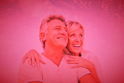 Closeup portrait of a happy mature couple having fun.
